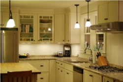 Dimmable under the counter halogen lighting with dimable incedcent pendant lighting above sink.